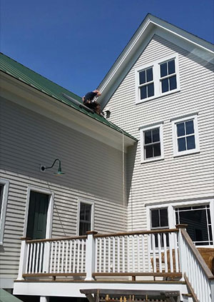 creature removal man-on-roof-doing-exclusion compressed file
