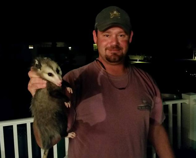 Photo: Owner of Triangle Wildlife  Removal holding an opossum on Apex, NC page